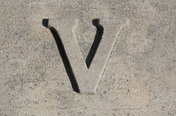 A raised stone version of the Roman numeral 'V'